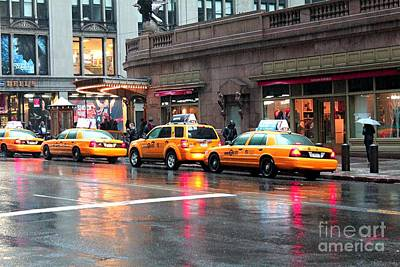 Poster featuring the photograph New York's Famous Cabs by Laurinda Bowling