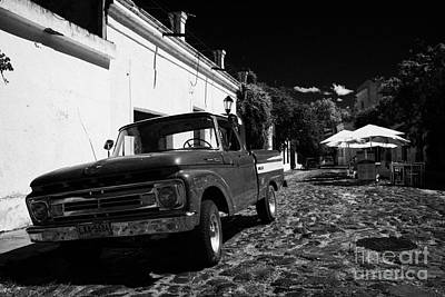old ford pickup truck on historic paved spanish street Barrio Historico Colonia Del Sacramento Poster