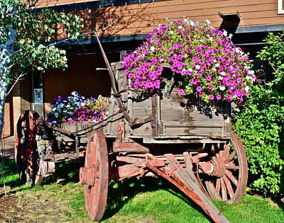 Old Wagon Wheel With Flowers Poster