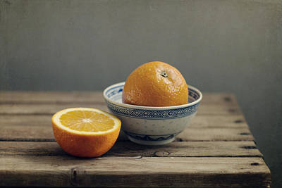 Orange In Chinese Bowl And Half Orange On Table Poster