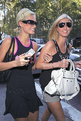 Paris Hilton, Nikki Hilton Carrying Poster