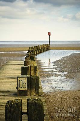 Pier Pilings By The Ocean Poster by Jon Boyes