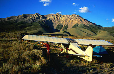 Pilot Of Ultralight Plane Taking Camping Excursion, Near Borah Peak, Idaho, United States Of America, North America Poster