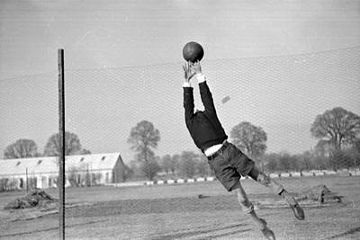 Playing In Goal Poster by Kurt Hutton