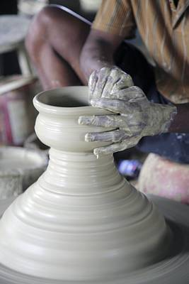 Potter Making Pot Of Clay Poster by Bjorn Svensson