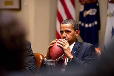 President Barack Obama Pensively Holds Poster by Everett
