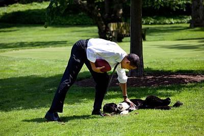 President Barack Obama Pets The Family Poster by Everett