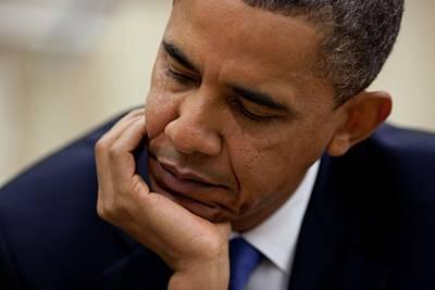 President Barack Obama Reads A Document Poster by Everett