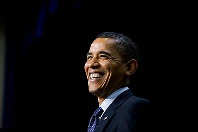 President Barack Obama Smiles While Poster
