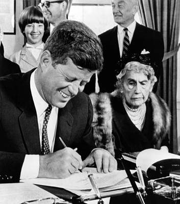 President John Kennedy Signs A Joint Poster by Everett