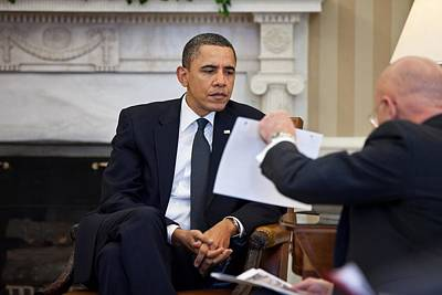 President Obama Studies A Document Held Poster by Everett