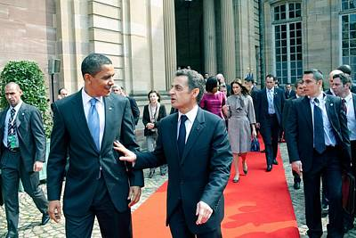 President Obama Walks With French Poster by Everett