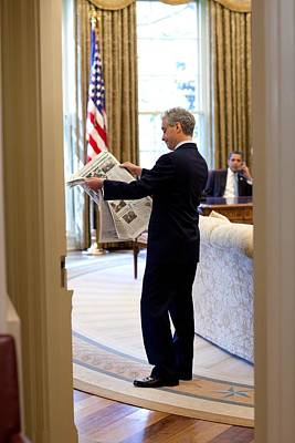Rahm Emanuel Looks At A Newspaper Poster by Everett