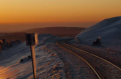 Railroad Tracks At Sunset In An Icy Poster by Norbert Rosing
