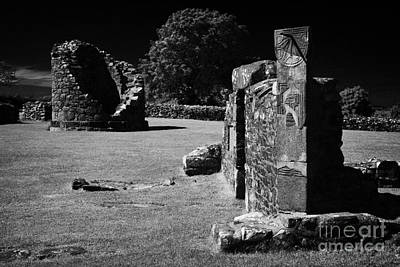Remains Of The 6th Century Round Tower And Reconstructed Sundial On The Monastic Site At Nendrum  Poster