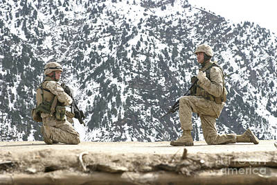 Riflemen Provide Security On A Rooftop Poster by Stocktrek Images