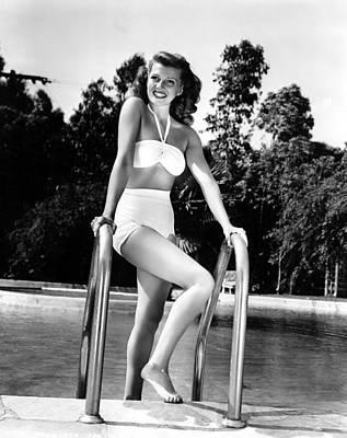 Rita Hayworth Relaxes At Home Via A Dip Poster