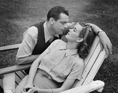 Romantic Couple Relaxing On Deckchair, (b&w) Poster