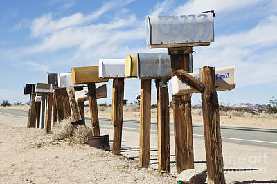 Row Of Mailboxes Along Desert Road Poster by Paul Edmondson