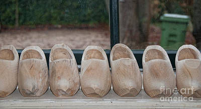 Rows Of Wooden Shoes Poster by Carol Ailles