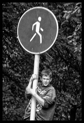 Poster featuring the photograph Russian Boy On Sign by Rick Bragan