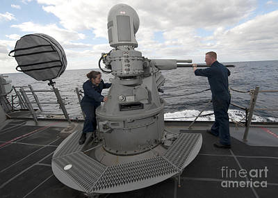 Sailors Conduct Maintenance On The Mk38 Poster