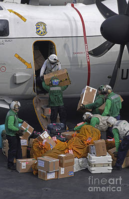 Sailors Load Mail On To A C-2a Poster by Stocktrek Images
