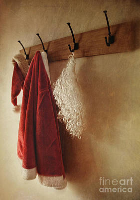 Santa Costume Hanging On Coat Rack Poster