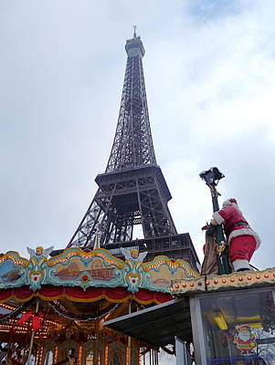 Santa Visits The Eiffel Tower Poster