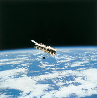 Satellite In Orbit Above Earth Poster by Stockbyte
