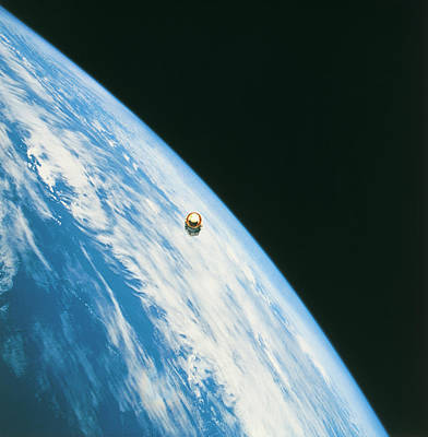 Satellite In Orbit Around The Earth Poster by Stockbyte