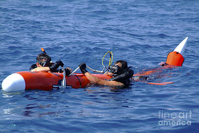 Search And Rescue Swimmers Retrieve Poster by Stocktrek Images