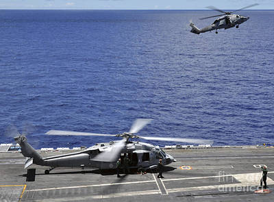 Sh-60 Sea Hawk Helicopters Land Aboard Poster by Stocktrek Images