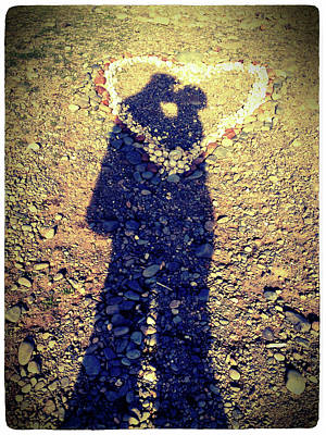 Shadows Of Couple Kissing Over Heart Of Stones Poster
