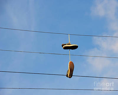 Shoes Hanging From Power Line Poster by David Buffington