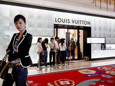Shoppers Await Entry Into The Louis Poster