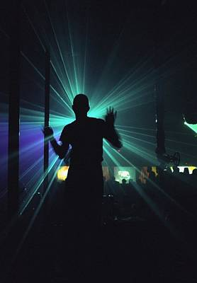 Silhouette Of Person Clubbing In Poster by Axiom Photographic