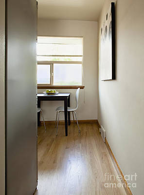 Small Table In A Sparse Room Poster