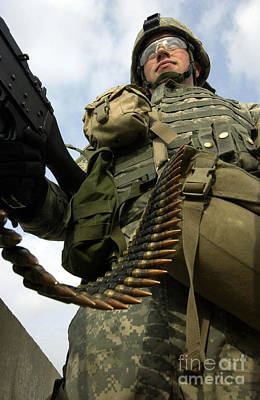 Soldier Mans A Vehicle Mounted 7.62 Mm Poster by Stocktrek Images