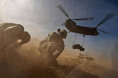 Soldiers In The Dust Of A Chinook Poster