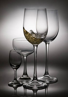 Splashing Wine In Wine Glasses Poster by Setsiri Silapasuwanchai