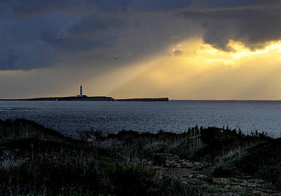 storm light - A morning light iluminates lighthouse through clouds in an amazing landscape Poster by Pedro Cardona