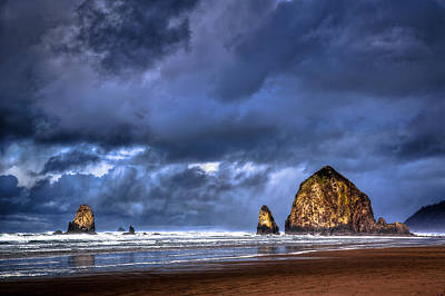 Stormy Clouds In Cannon Beach Poster by Niels Nielsen