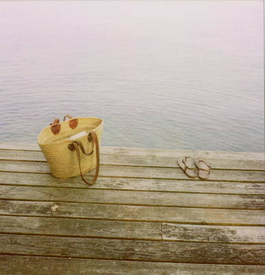 Straw Basket And Sandals On Wooden Lake Dock Poster by Brooke Schmidt