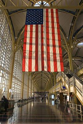 Sun Lighting Up An American Flag Poster by Rich Reid