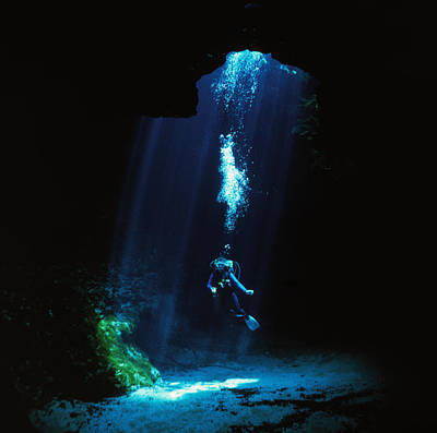 Sunlight Streams Into The Blue Hole Poster by Wes C. Skiles