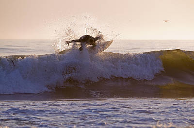 Surfer At Dusk Riding A Wave At Rincon Poster by Rich Reid