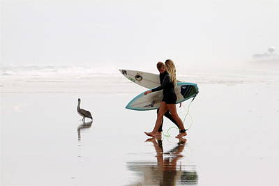 Poster featuring the photograph Surfers And A Pelican by Alice Gipson