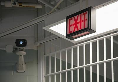 Surveillance Camera Exit Sign Poster by Roberto Westbrook