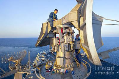 Technicians Perform Maintenance Poster by Stocktrek Images